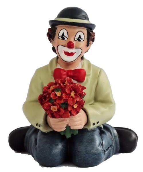 Florius hockend, rote Blumen